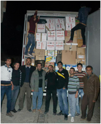 One of our friends' teams in Switzerland provided food to refugees. The truck is being unloaded in Turkey