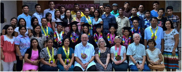With graduates and faculty of our school in the Philippines.